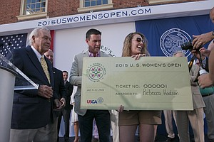 Arnold Palmer presents a ceremonial first ticket to fan Rebecca Hodson in Lancaster, Pa., host of the 2015 U.S. Women's Open.