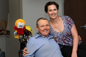 Jarrod Lyle poses for a quick portrait with his wife, Briony, at the Golf Channel studios in Orlando.