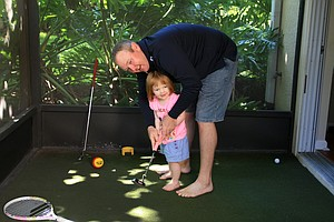 Jarrod Lyle gets in some putting practice with his daughter at home in Orlando.