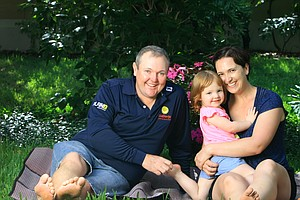 Jarrod Lyle with his baby girl, Lusi Joy, 2, and wife, Briony, at home in Orlando.
