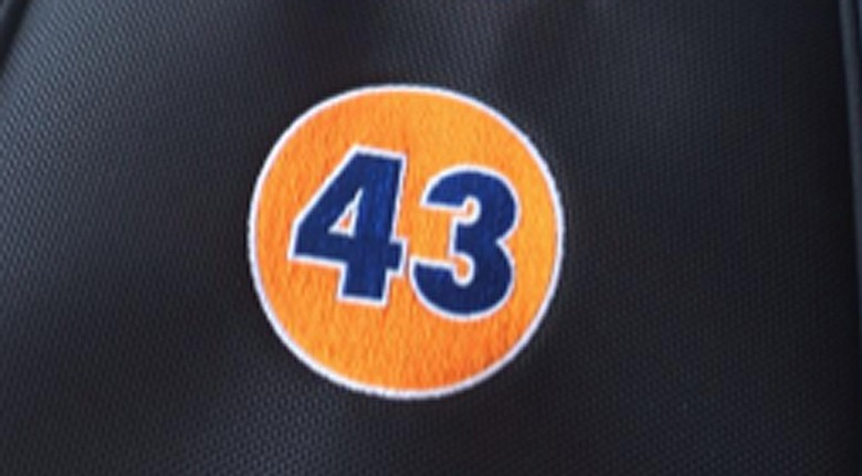 Jason Dufner will honor former Auburn football player Philip Lutzenkirchen, who died last month, with this orange and blue No. 43 patch on his bag.