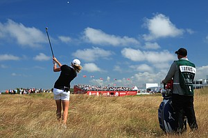 Stacy Lewis and her caddie Travis Wilson during the first round of the 2014 Ricoh Women's British Open at Royal Birkdale Golf Club in Southport, England.