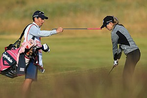 Paula Creamer and her caddie Colin Cann during the second round of the 2014 Ricoh Women's British Open at Royal Birkdale Golf Club in Southport, England.