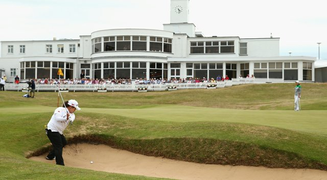 Sun Ju Ahn hits her third shot at the par-5 18th during the third round of the 2014 Ricoh Women's British Open at Royal Birkdale Golf Club in Southport, England. Ahn was given a two-shot penalty after building her stance on this shot from the bunker.