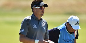 Poulter will play British Open with sore wrist