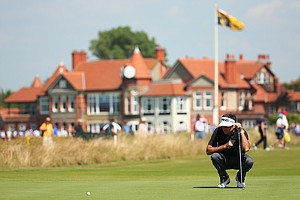 Bubba Watson lines up his putt on the third hole during the first round of the 2014 Open Championship.