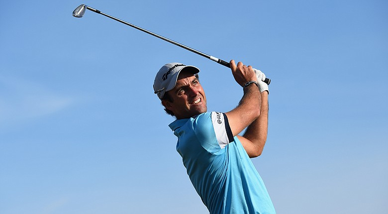 Edoardo Molinari tees off on the fifth hole during the first round of the Open Championship at Royal Liverpool.