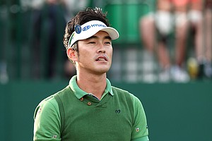 Hyung-Sung Kim watches his drive on the first hole during his first round of the 2014 Open Championship.