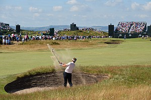 Ian Poulter plays a bunker shot on the fifth hole during the first round of the Open Championship at Hoylake.