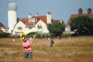 Marc Leishman hits from the rough during the first round of the Open Championship at Royal Liverpool.