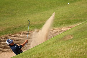 Ryo Ishikawa plays a bunker shot on the 10th hole during the first round of the 2014 Open Championship.