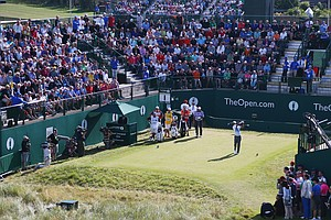 Tiger Woods tees off on the first hole during the first round of the Open Championship at Royal Liverpool.