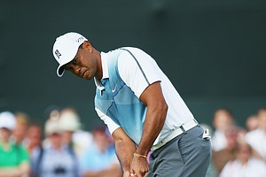 Tiger Woods putts on the second green during the first round of the Open Championship at Royal Liverpool.