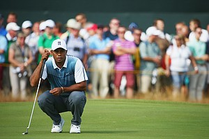 Tiger Woods lines up his putt on the third green during the first round of the Open at Royal Liverpool.