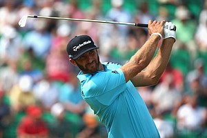 Dustin Johnson hits his tee shot on the fourth hole during the second round of the 2014 British Open at Hoylake.