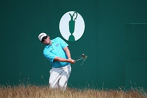 George Coetzee hits a pitch shot to the 18th green during the second round of the 2014 British Open.
