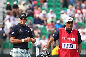Ian Poulter waits on the fourth tee with his caddie Terry Mundy during the second round of the 2014 British Open.