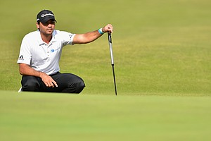 Jason Day lines up a putt on the second hole during the second round of the British Open at Royal Liverpool.