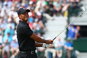 Tiger Woods watches his tee shot on the fourth hole during the second round of the 2014 British Open.