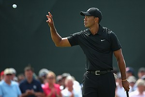 Tiger Woods catches his ball on the 2nd green during the second round of the British Open at Royal Liverpool.