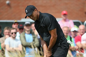 Tiger Woods reacts to a missed putt on the first green during the second round of the 2014 British Open.