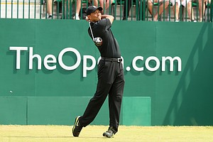 Tiger Woods watches his tee shot on the first hole during the second round of the 2014 British Open.