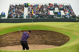 Bill Haas hits from a bunker on the sixth hole during the third round of the 2014 British Open.