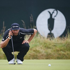 Dustin Johnson lines up on the third green during the third round of the 2014 British Open.