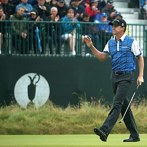 Jimmy Walker acknowledges the crowd on the third green during the third round of the 2014 British Open.