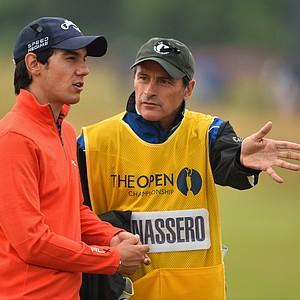 Matteo Manassero talks with his caddie/coach Alberto Binaghi during the third round of the 2014 British Open.