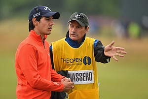 Matteo Manassero talks with his caddie/coach Alberto Binaghi during the third round of the 2014 British Open.