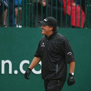 Phil Mickelson walks to the first tee during the third round of the 2014 British Open at Royal Liverpool.