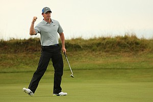 Rory McIlroy celebrates a birdie putt on the 14th green during the third round of the 2014 British Open.