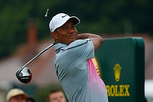 Tiger Woods tees off on the 10th hole during the third round of the British Open at Royal Liverpool.