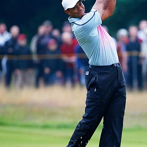 Tiger Woods hits his second shot on the 10th hole during the third round of 2014 British Open.