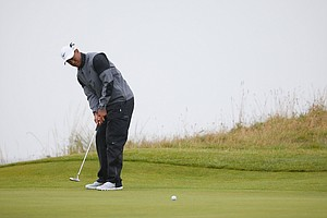 Tiger Woods putts on the 14th green during the third round of the 2014 British Open at Hoylake.