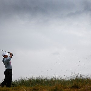 Tiger Woods tees off on the 13th hole during the third round of the 2014 British Open at Royal Liverpool.