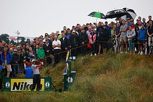 Tiger Woods tees off on the 14th hole during the third round of the 2014 British Open at Royal Liverpool.