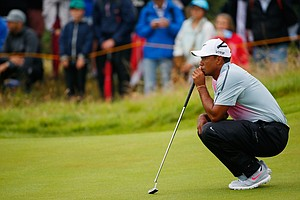 Tiger Woods lines up a putt on the 10th green during the third round of the 2014 British Open at Royal Liverpool.