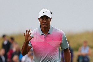 Tiger Woods acknowledges the crowd during the third round of the British Open at Royal Liverpool.