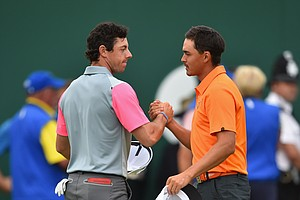 Rickie Fowler (right) congratulates Rory McIlroy after his 2014 British Open championship at Royal Liverpool in Hoylake, England.