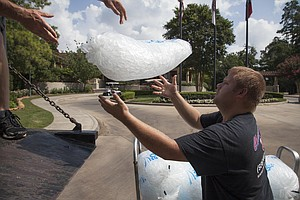 Workers deliver ice during the first round of the 2014 U.S. Junior Amateur on Monday at The Club at Carlton Woods in The Woodlands, Texas.