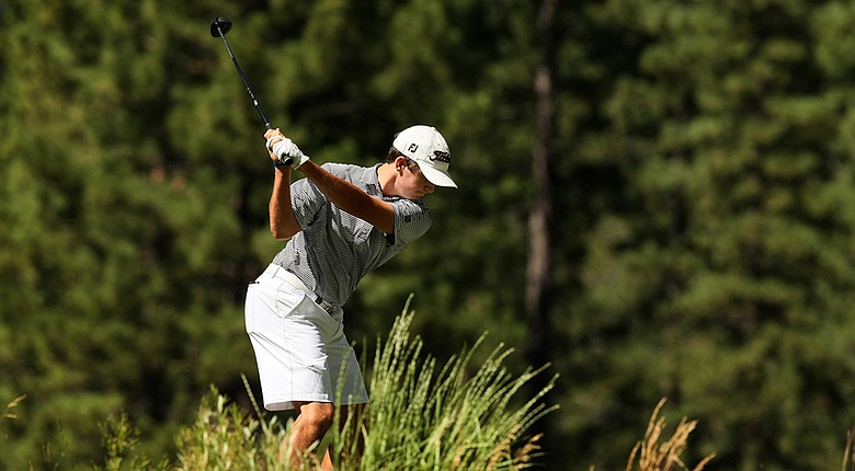 Davis Riley, last year's U.S. Junior Amateur runner-up, fired a 5-under 67 to take the first-round lead on a hot day in The Woodlands, Texas.