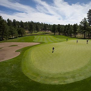 Abbey Carlson putts at the scenic par-3 17th hole during Monday's first round of the USGA's 2014 U.S. Girls' Junior Championship at at Forest Highlands Golf Club in Flagstaff, Ariz.