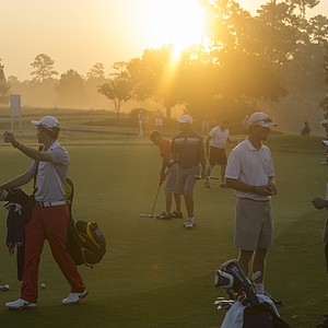 Players practice before their first round of the 2014 U.S. Junior Amateur Monday at The Club at Carlton Woods in The Woodlands, Texas.