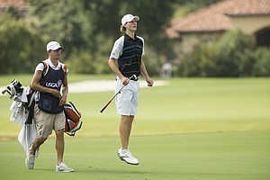 Trevor Ranton tries to peek at a shot during Monday's first round at the 2014 U.S. Junior Amateur Championship at The Club at Carlton Woods in The Woodlands, Texas.