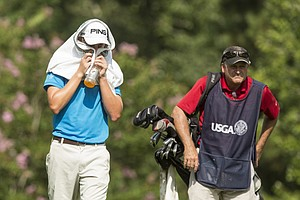 Kyle Hogan seeks relief from the heat during the first round of the 2014 U.S. Junior Amateur on Monday at The Club at Carlton Woods in The Woodlands, Texas.