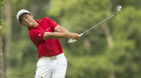 Andy Zhang hits a shot during the 2014 U.S. Junior Amateur at The Club at Carlton Woods in The Woodlands, Texas.