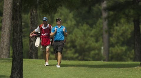 Sam Horsfield walks with his caddie and coach, Jason Bell, during the Round of 32 of the 2014 U.S. Junior Amateur.