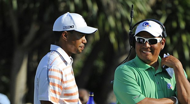 Tiger Woods will play in a tournament that benefits the charitable foundation of former Stanford teammate Notah Begay III between two 2014 FedEx Cup playoff events (Woods and Begay shown here last year at Doral).